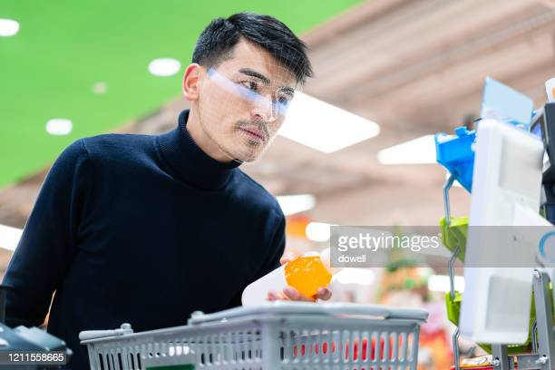 contactless payment with facial recognition - business security camera stock pictures, royalty-free photos & images