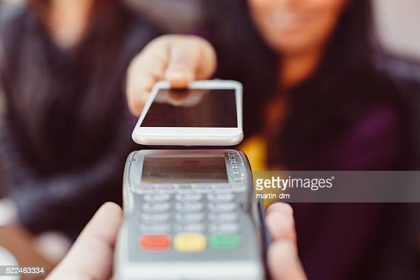 Contactless payment with smartphone in a cafe