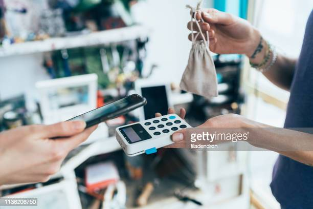 contactless payment with smartphone - money transfer stock pictures, royalty-free photos & images