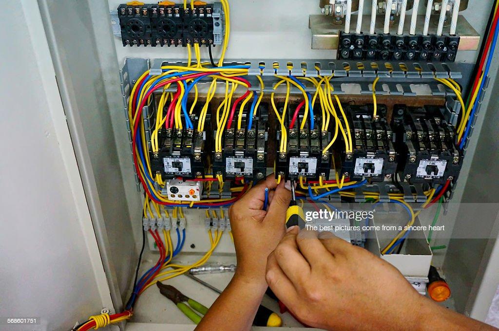 Contactor wiring work : Stock Photo
