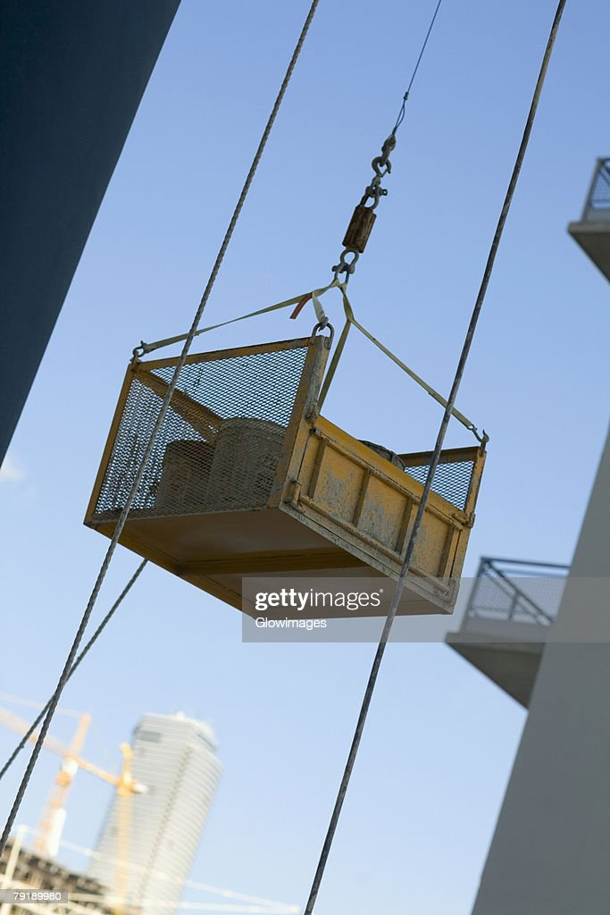 Container attached to the pulley of a lift : Stock Photo