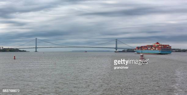 Container Barge at the Verrazano-Narrows Bridge in New York