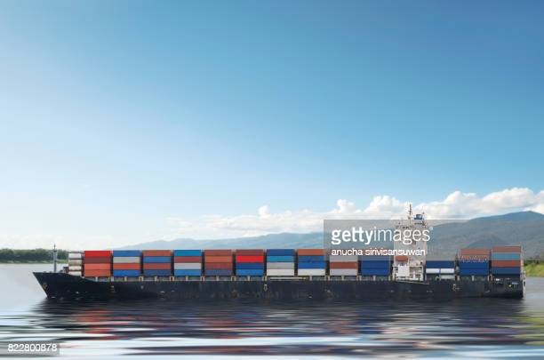 container cargo ship in blue sky , background , texture . - cargo ship stock pictures, royalty-free photos & images