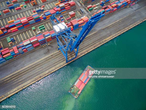 container cargo Ship parked Harbor cranes .