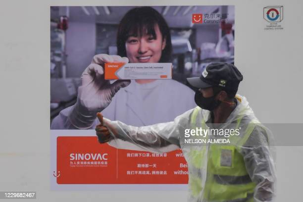 Container carrying doses of the CoronaVac vaccine is unloaded from a cargo plane that arrived from China at Guarulhos International Airport in...