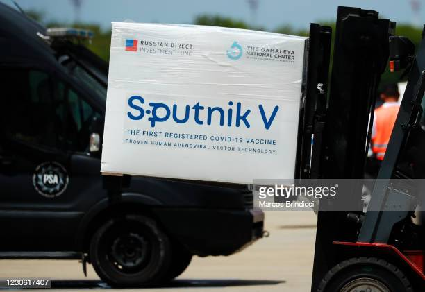 Container carrying part of the second batch of 300,000 doses of Sputnik V vaccine is moved by a forklift after it's arrival from Russia at Ministro...