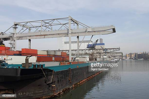 container crane and freight containers in river port - basel port stock photos and pictures