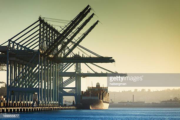 container cranes and cargo ship at port of la [horizontal] - long beach california stock photos and pictures