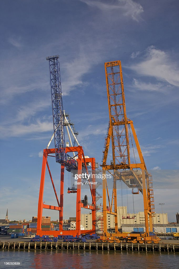 Container cranes in late afternoon against sky. : Stock Photo