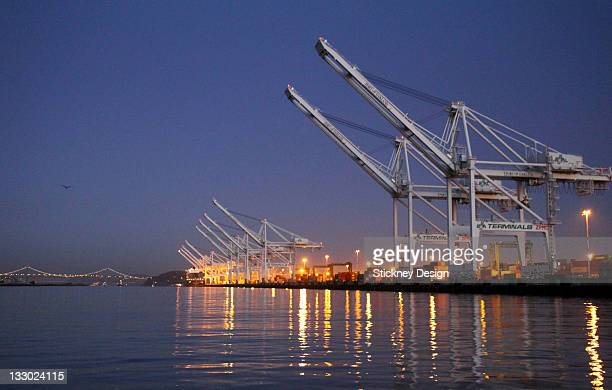 Container cranes in Port of Oakland dawn Estuary