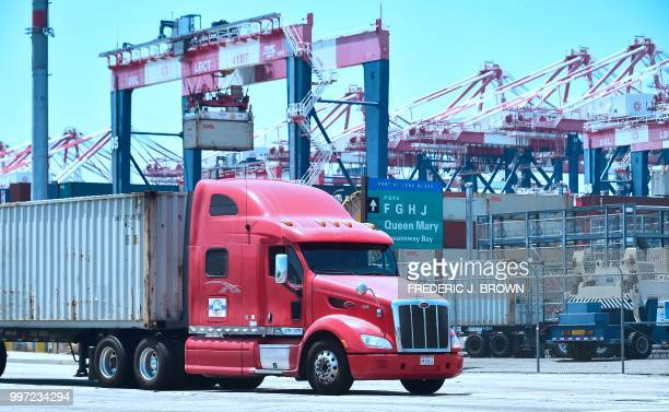 A container delivery truck heads for one of the terminals at the Port of Long Beach on July 12 2018 in Long Beach California one of the world's...