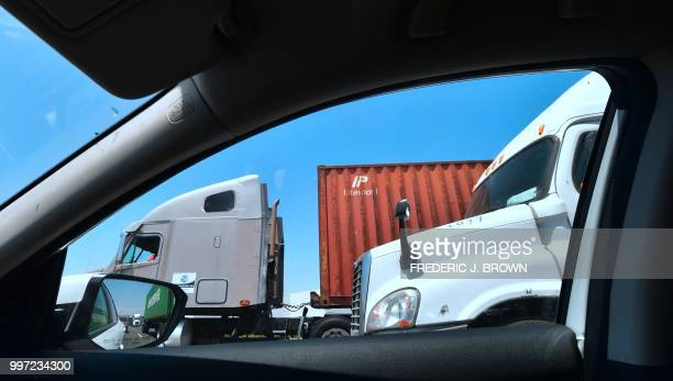 Container delivery trucks make their way south on the 710 freeway heading to the Port of Long Beach on July 12 2018 in Long Beach California one of...