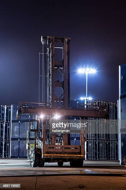 Container Forklift in Yard at Night