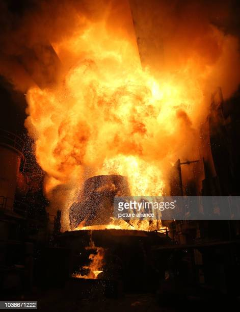 A container full of scrap metal is poured into an electric arc furnace at the ArcelorMittal steel plant in Hamburg Germany 25 March 2013 The world's...