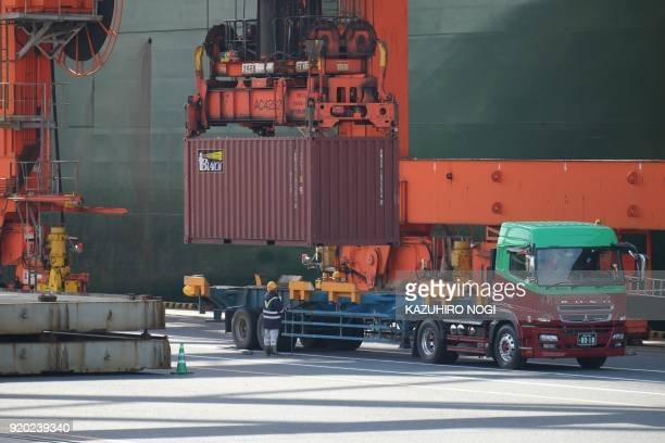 A container is unloaded onto a truck at the international cargo terminal at Tokyo's port on February 19 2018 Japan logged a trade deficit in January...