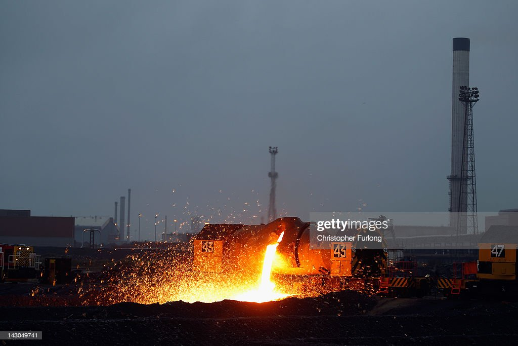 A container known as a 'torpedo' purs aways slag that has been tapped off the furnace at the SSI steel works after making its first steel slab in two years on April 18, 2012 in Redcar, England. The former Corus owned furnace was mothballed two years ago but was bought by Thai firm Sahaviriya Steel Industries (SSI) who have given jobs back to many of the 1,600 workers who lost their jobs.