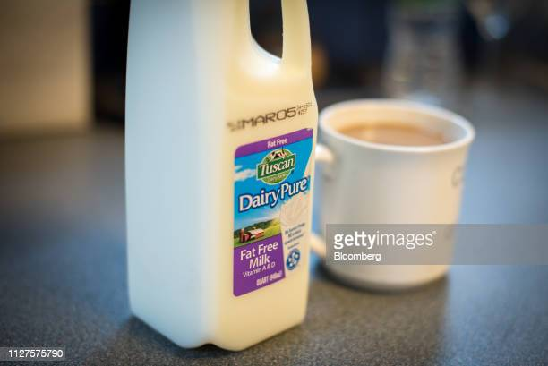 A container of Dean Foods Co Dairy Pure brand fat free milk is displayed for a photograph in Dobbs Ferry New York US on Wednesday Feb 20 2019 Dean...