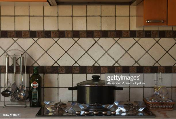 Container On Gas Stove In Kitchen