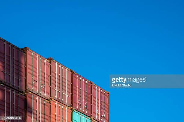 container port with blue sky - sea channel stock photos and pictures