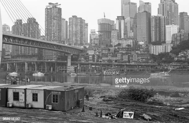 container sheds on riverbed against downtown skyline,chongqing,china - skyscraper film stock pictures, royalty-free photos & images