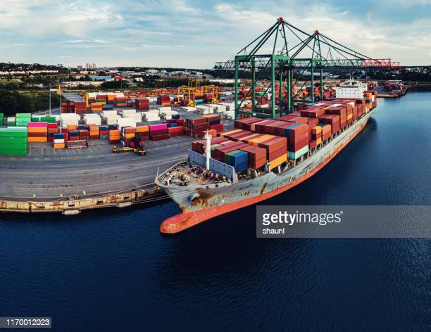container ship at port - commercial dock stock pictures, royalty-free photos & images