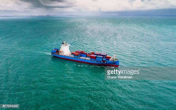 container ship at sea, aerial view - cargo ship stock pictures, royalty-free photos & images