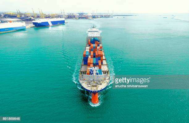 container ship being shipping out of stock port by sea, thailand.