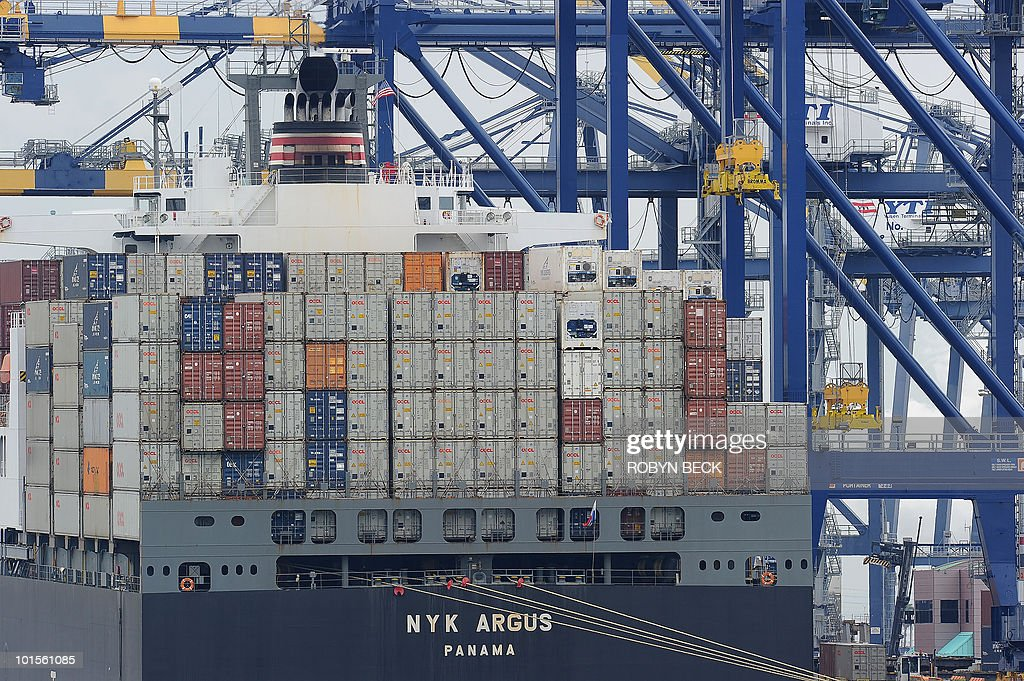 A container ship being unloaded is visible during the launch voyage of the Aquarium of the Pacific�s new 'Urban Ocean' cruise, May 27, 2010 in San Pedro Bay off the coast of Los Angeles and Long Beach, California. The cruise gives passengers the chance to see the intensive and varied human uses of one of the most urbanized coastlines in the world while highlighting how marine wildlife manages to exist and occasionally even to thrive in this heavily urbanized marine - industrial complex. This portion of the Pacific Ocean�s coast, centered around the Ports of Los Angeles and Long Beach, is utilized for such diverse purposes as shipping, recreation, tourism, fishing and offshore oil drilling while also serving as home to a wastewater disposal facility, a federal prison, and even a sea-based spacecraft launch service, all of which can be seen during the two-hour cruise.