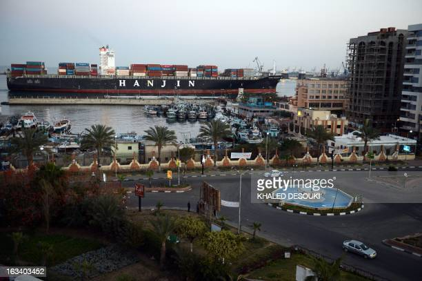 Container ship belonging to Korea's Hanjin shipping, sails down the Suez Canal city of Port Said on March 9, 2013. Traffic in the Suez Canal, a vital...