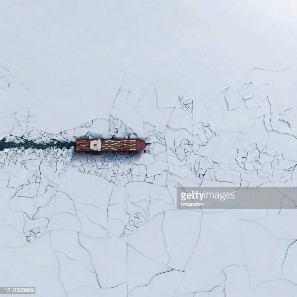 container ship breaking ice - risk stock pictures, royalty-free photos & images