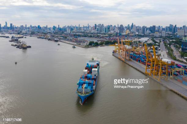 container ship business freight import export logistic and transportation by container ship, aerial front view. - darsena foto e immagini stock