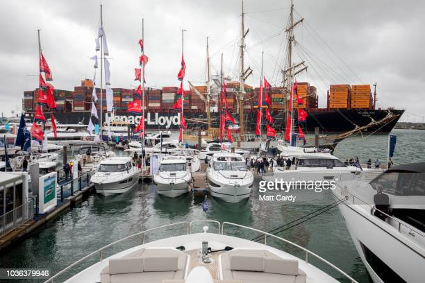 People look at adverts for boats for sale at TheYachtMarketcom Southampton Boat Show at Mayflower Park on September 20 2018 in Southampton England...