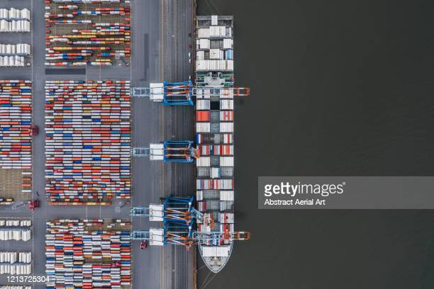container ship docked in port as seen from above, germany - harbour stock pictures, royalty-free photos & images