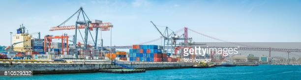 Container ship docks busy shipping container cargo port Lisbon Portugal