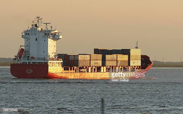 A container ship heads toward the North Sea on the Elbe River August 3 2007 at Brunsbuettel Germany Northern Germany with its busy ports of Hamburg...