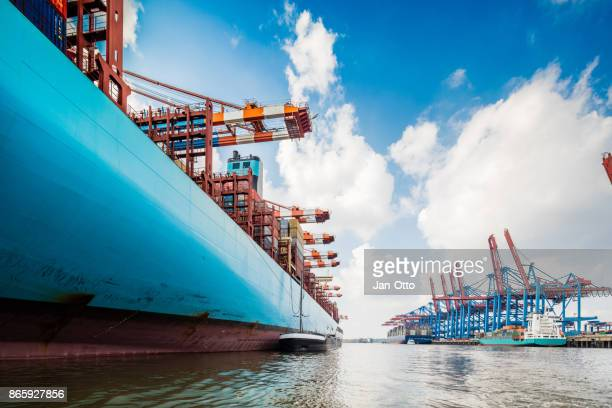 container ship in hamburg harbour - cargo ship stock pictures, royalty-free photos & images