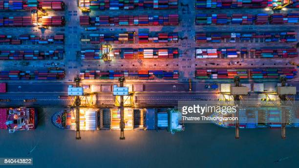 container ship in import export and business logistic, by crane, trade port, shipping cargo to harbor, aerial view from drone, international transportation, business logistics concept - saudi stock pictures, royalty-free photos & images
