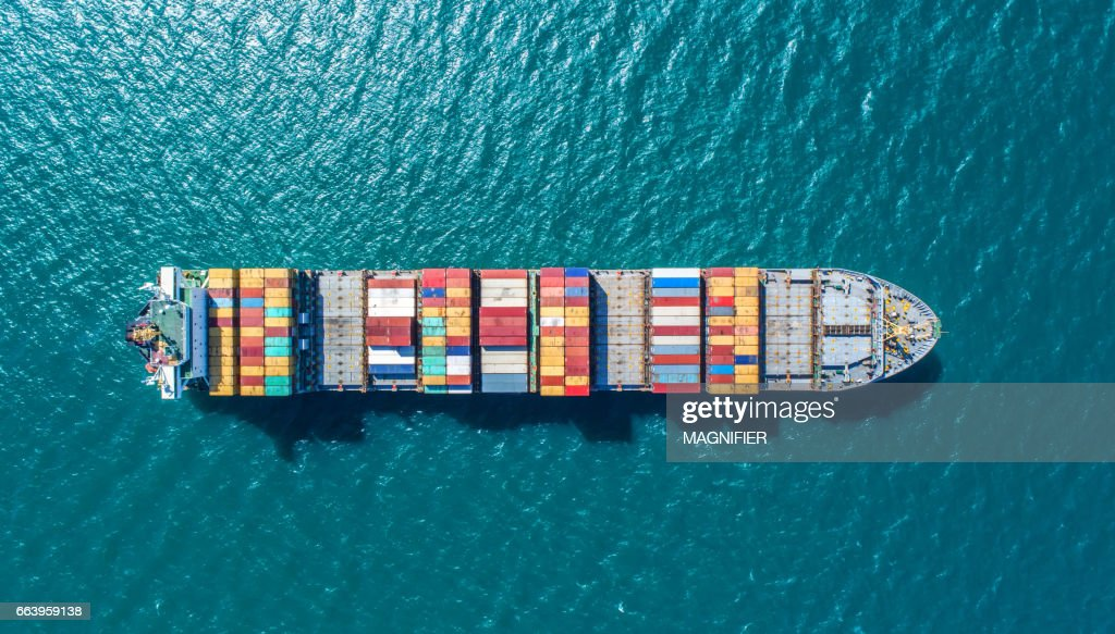 container ship in import export and business logistic.By crane ,Trade Port , Shipping.cargo to harbor.Aerial view.Water transport.International.Shell Marine.Top view. : Stock Photo