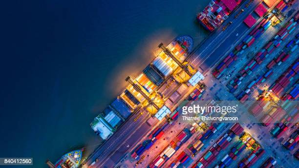 container ship in import export and business logistics, by crane, trade port, shipping cargo to harbor - commercial dock stock pictures, royalty-free photos & images