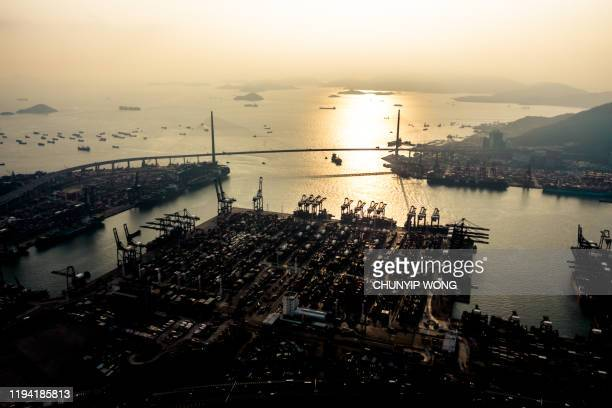 container ship in the harbor at sunset - global trade war stock pictures, royalty-free photos & images