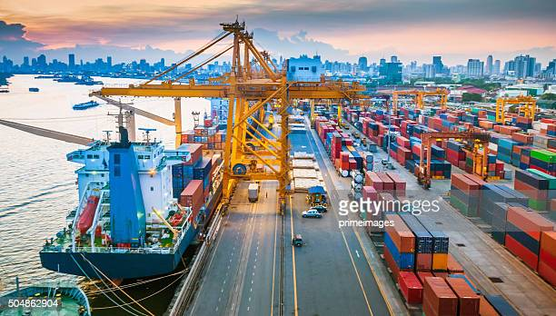 container ship in the harbor in asia , - cargo ship stock pictures, royalty-free photos & images