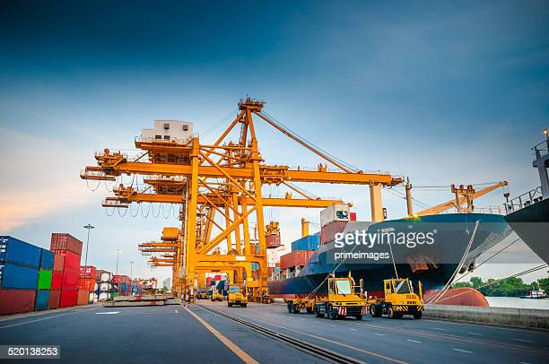 container ship in the harbor in asia , - slave ship stock photos and pictures