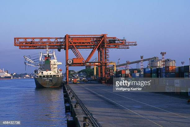 A container ship is being unloaded in the port of Cochin in India