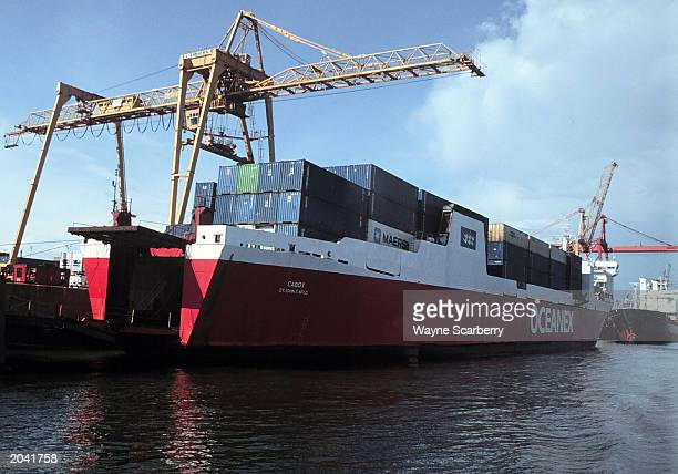 A container ship is docked at a crane in the Port of Montreal along the St Lawrence River in Montreal Quebec Canada August 5 1999 Montreal has the...