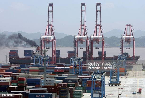 A container ship is loaded while docked at Ningbo Port 09 June 2005 in China's southeastern Zhejiang province Located in the middle of China's...