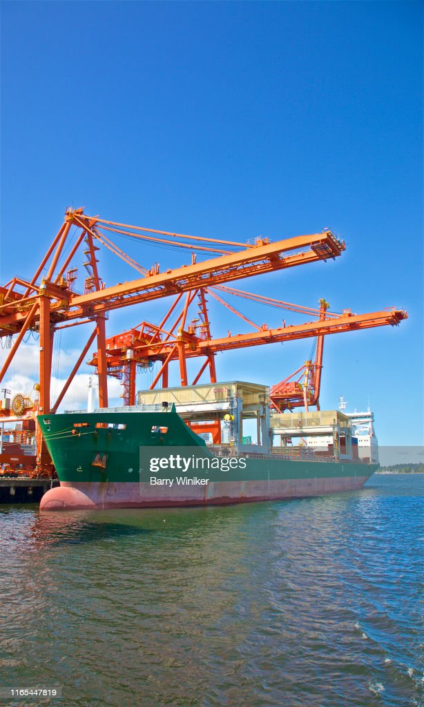 Container ship loading at DP World, (Centerm), Vancouver, British Columbia : Stock Photo
