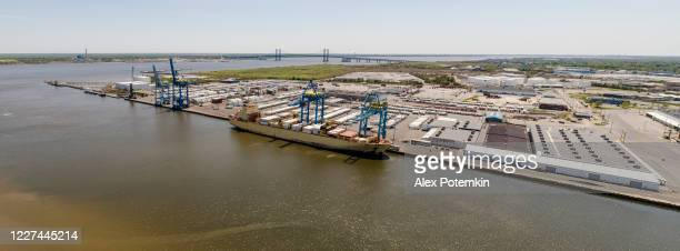 a container ship loading in a port. aerial stitched panorama. - wilmington delaware stock pictures, royalty-free photos & images
