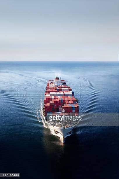 container ship on open ocean - cargo ship stock pictures, royalty-free photos & images