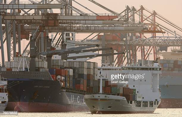 A container ship passes other container ships upon arriving at the main container port August 13 2007 in Hamburg Germany Northern Germany with its...