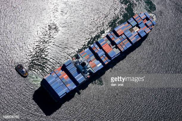 container ship - tugboat stock photos and pictures